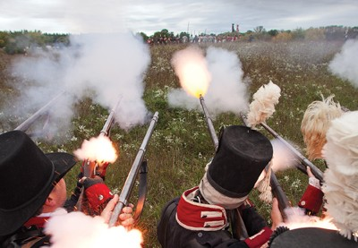LONDON, ONTARIO - October 2, 2011.   British soldiers engage in  battle during a reenactment of the War of 1812 at  Fanshawe Pioneer Village in London, Ontario on October 1, 2011.    Photo by Colin O'Connor for Maclean's