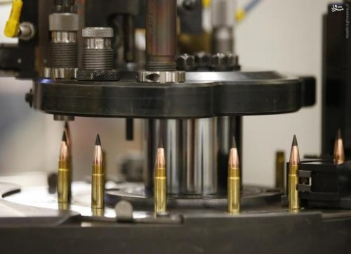 A machine assembles powder, cartridges and bullet tips together to make a .308 caliber round at Barnes Bullets in Mona, Utah, January 6, 2016. REUTERS/George Frey