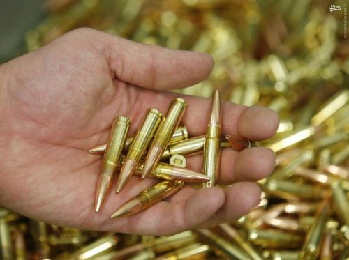 A worker holds finished 300 AAC Blackout rounds at Barnes Bullets in Mona, Utah, January 6, 2016. REUTERS/George Frey