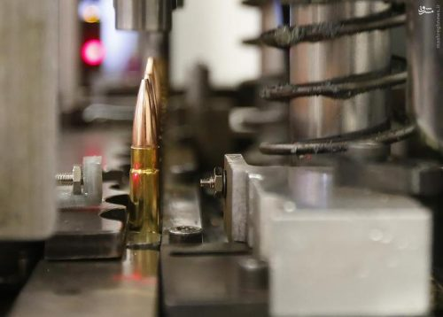 A machine assembles powder, cartridges and bullets tips together to make 300 AAC Blackouts at Barnes Bullets in Mona, Utah, January 6, 2016. REUTERS/George Frey
