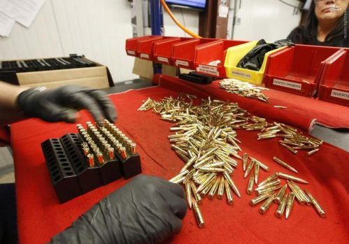 A worker puts finished 300 AAC Blackout rounds into packaging at Barnes Bullets in Mona, Utah, January 6, 2016. REUTERS/George Frey