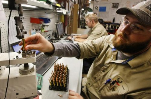 A worker tests bullets for correct tolerances at Barnes Bullets in Mona, Utah, January 6, 2016. REUTERS/George Frey