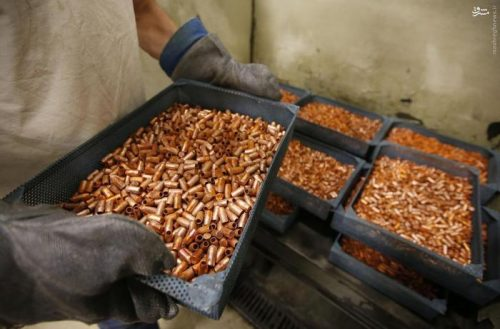 A worker transfers newly made copper slugs, to be pressed into bullets, at Barnes Bullets in Mona, Utah, January 6, 2016. REUTERS/George Frey